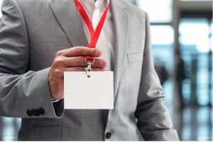 Business man holding their badge to get into office